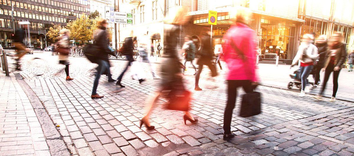 Blurred people in motion in a pedestrian street